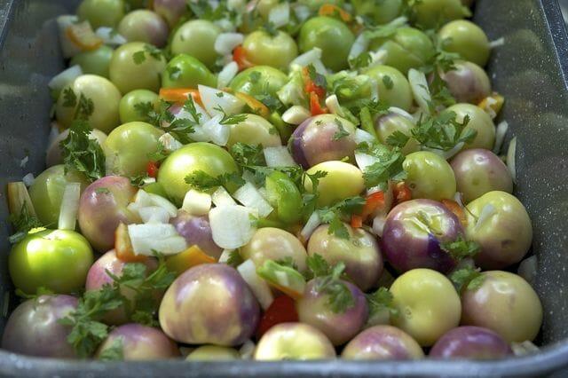 tomatillo jam ingredients in roasting pan.